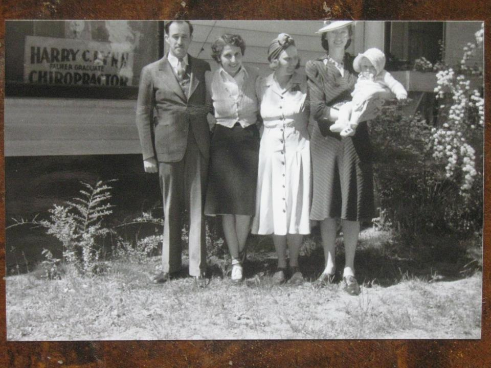 Harry C. Lynn? Chiropractor (left), with May Sandberg D.C (2nd from right) and baby Larry Sandberg D.C. (held by unknown woman) c.a 1940